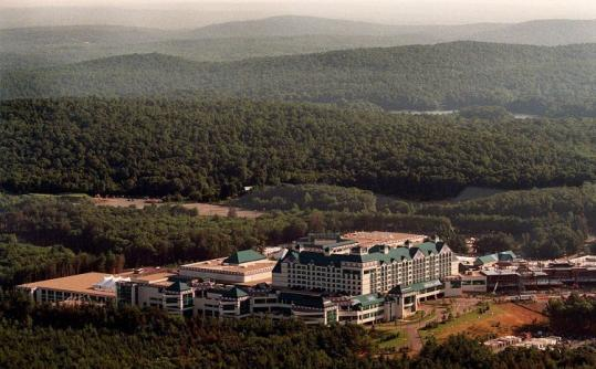 A downturn has rippled through the casino industry, forcing businesses like Foxwoods (above) to lay off employees.