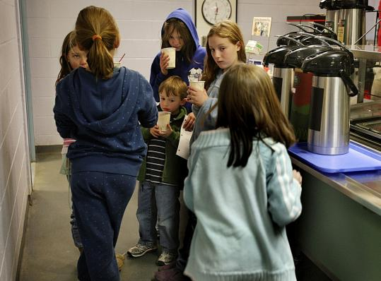 Hot chocolate held some comfort for young Harvard residents taking shelter yesterday at the Bromfield School.