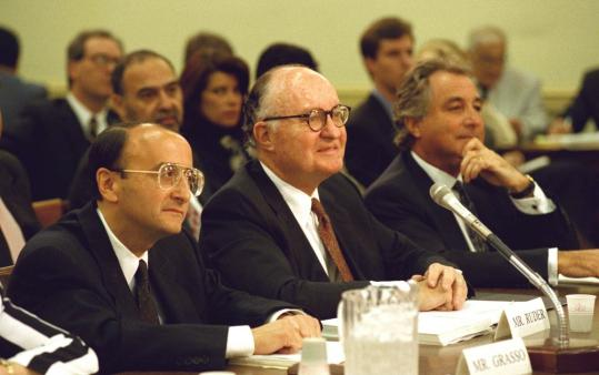 In this 1993 photo, Bernard Madoff (right) appeared at a House subcommittee hearing in Washington with Richard Grasso, then president of the New York Stock Exchange (left), and a former Securities and Exchange Commission chairman, David S. Ruder.