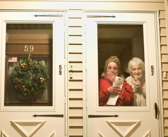 Carol Deady and her mother, Rose DeMattia, welcome a group in front of their home.