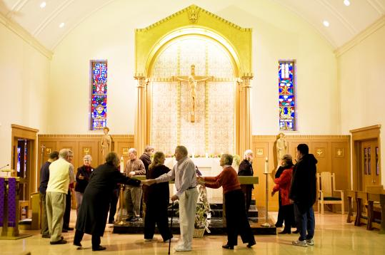 Parishioners conducting a vigil at St. James the Great in Wellesley gather for a lay-led Communion service on a recent Sunday morning.