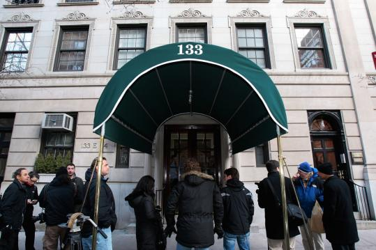 Members of the media gather outside the home of Bernard Madoff yesterday in New York City.