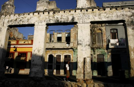 A man walked past the ruins of a home in Havana yesterday. Cubans are hopeful President-elect Barack Obama will lift some US restrictions on travel to the impoverished country.