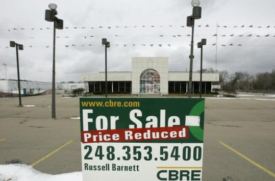 Detroit, based on many measures, is the nation's most beleaguered city. Pictured here is a vacant auto dealership.