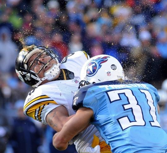 Steelers receiver Hines Ward paid the price after hauling in a 21-yard touchdown pass, getting rocked by the Titans' Cortland Finnegan.