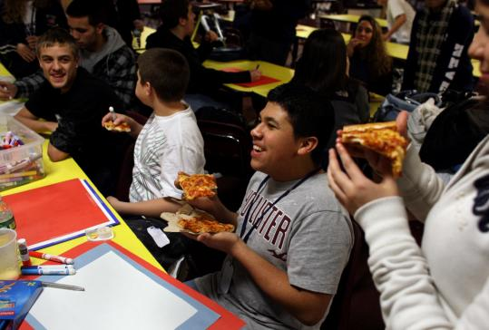 Jefferson Clavel and Revere High classmates enjoyed a pizza party at the Power of Know Club.