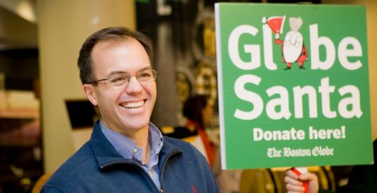 NESN sportscaster Tom Caron helped Globe Santa Saturday at the TD Banknorth Garden before the Bruins game. Every dollar donated to the drive is used to purchase and deliver presents.