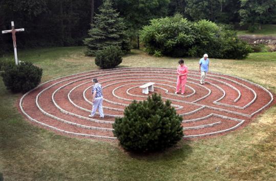 Women walk the labyrinth at the Miramar Retreat Center in Duxbury.