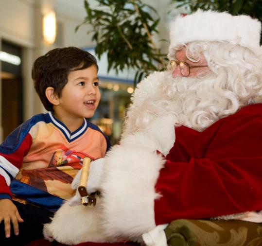 Nathan Morah, 4, from Nantucket, meets Globe Santa Sunday at the Prudential Center. This year Globe Santa is providing holiday gifts for more than 54,000 children.