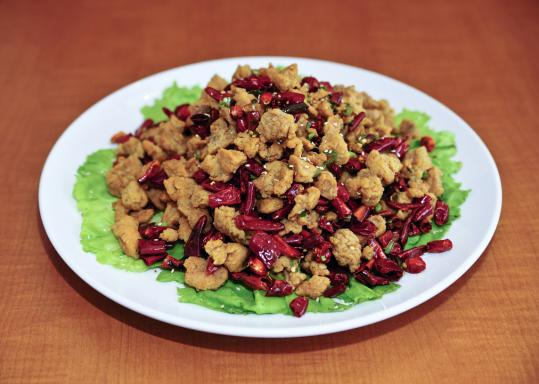 Diners braving the winter chill can warm up with diced chicken fried with chili peppers.