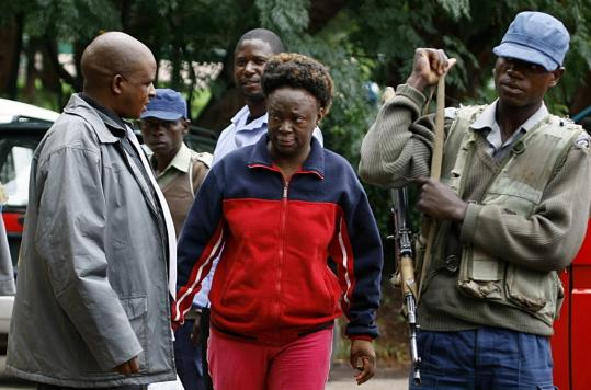 Zimbabwean human rights activist Jestina Mukoko was taken to court yesterday in Harare. She is accused of trying to overthrow President Robert Mugabe, a charge that many believe is false.