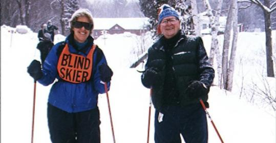 Cindy Wentz, legally blind since birth, hits the trail with guide Earl Prentiss during a New England Ski For Light outing.