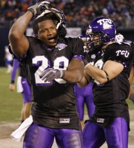 TCU safety Stephen Hodge (left) celebrates after a fourth-quarter interception.