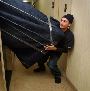 Nice Joe Perrone, Of Sal Giangrandeu0027s Crew, Pushes A Piece Of A Dismantled Couch  Through
