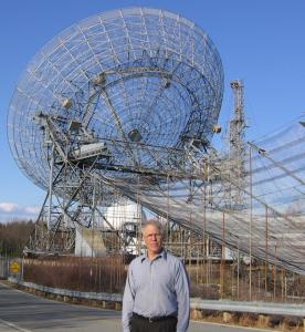 Dr. John Foster, in this 2006 photo, uses a large antenna at the MIT Haystack Observatory to study space weather.