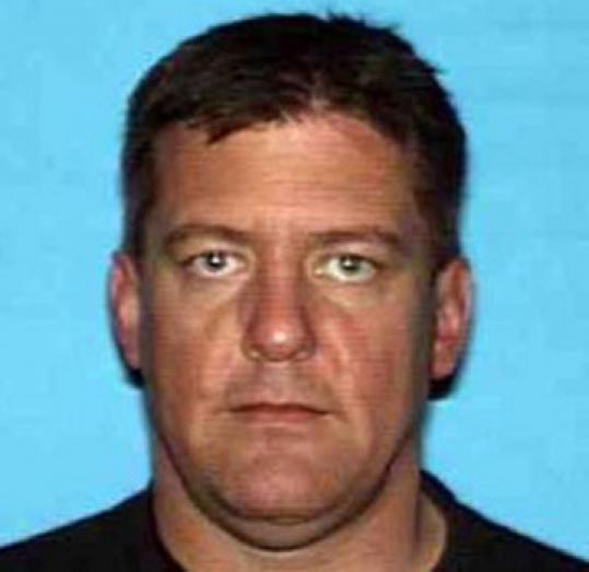 Bruce Pardo was found dead with $17,000 in cash and a plane ticket to Canada.