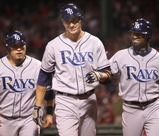 With the Sox in need of a fourth outfielder, free agent and New England native Rocco Baldelli (center) is one possibility.