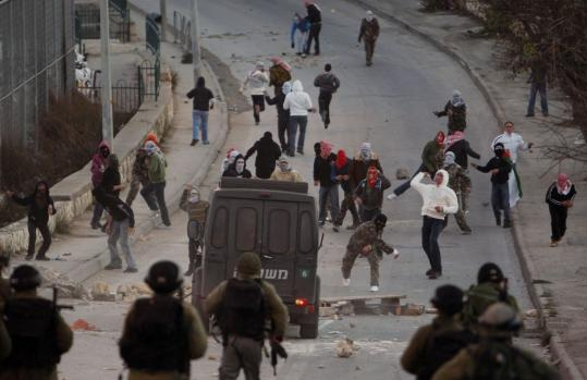 Palestinian youths threw stones at Israeli border police in the village of Issawiya in Arab East Jerusalem yesterday.