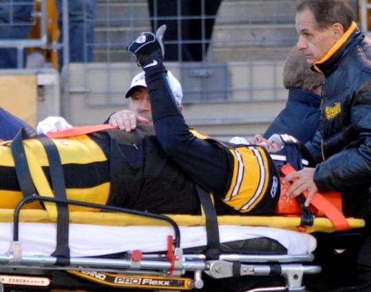 Immobilized after a second-quarter hit against the Browns, Ben Roethlisberger (concussion) signals to Steelers fans that he's OK.