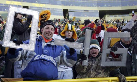 Lions and Packers fans alike were well aware that history was being made at Lambeau Field.