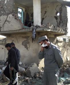 An Afghan police officer wounded in the blast walked at the site of the suicide attack in Khost province.