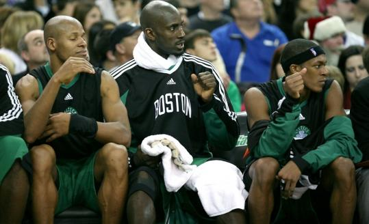 Celtics starters (from left) Ray Allen, Kevin Garnett, and Rajon Rondo get down time in the second half.