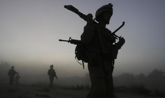 US Marines from the 24th Marine Expeditionary Unit patrolled in Garmser, in Afghanistan's Helmand Province, in July.