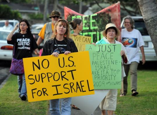 A handful of pro-Palestinian activists protested yesterday near the Hawaii vacation home of President-elect Barack Obama, urging a new approach to the Middle East. Obama did not acknowledge the protesters as he went by in his motorcade.