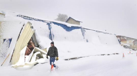 The nearly 60 inches of snow that has fallen in Spokane, Wash., this month has led to several roof collapses.