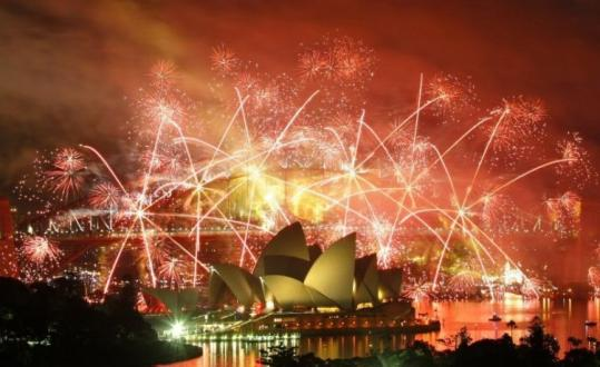 A pyrotechnic show ushered in Australia's new year over the Sydney Harbour Bridge and Opera House. Below, people in Hong Kong counted down the waning minutes while welcoming 2009 with numeric balloons.
