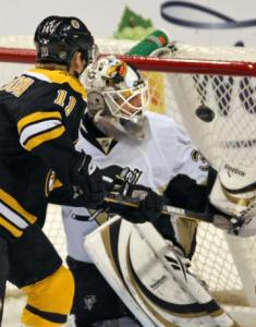 P.J. Axelsson's tip eluded goaltender Dany Sabourin to give the Bruins a 2-1 lead.