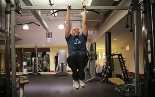 Jim Lauletta of Roslindale had to end his personal training sessions at Revolution Fitness in Boston and works out on his own.