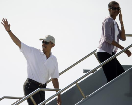 Barack Obama waved farewell in Honolulu Thursday as he and his wife, Michelle, boarded their flight for Chicago. Obama is to arrive tomorrow in Washington, where he will continue pressing for quick passage of an economic rescue plan.