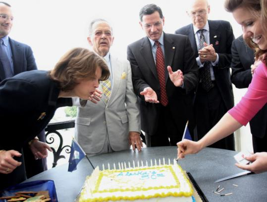 Senator Lisa Murkowski of Alaska blew out candles June 26 to mark the anniversary of Congress's approval of a bill to grant Alaska statehood. President Eisenhower signed it Jan. 3, 1959.