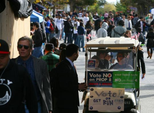 College Democrats used a golf cart to encourage voters on Election Day at UC-Berkeley.
