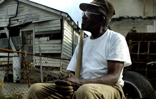 Rebuilding in the wake of Hurricane Katrina, 83-year-old Herbert Gettridge rests in the backyard of the New Orleans house he built in 1943.