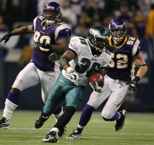 With Vikings Fred Evans (90) and Chad Greenway in pursuit, the Eagles' Brian Westbrook scoots for a 71-yard TD reception.
