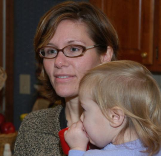 Janis Mars Wunderlich (holding Eliza) is one of the artists profiled in the film.