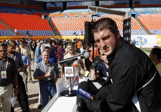 Surrounded at media day, Florida QB Tim Tebow is accustomed to being the center of attention.
