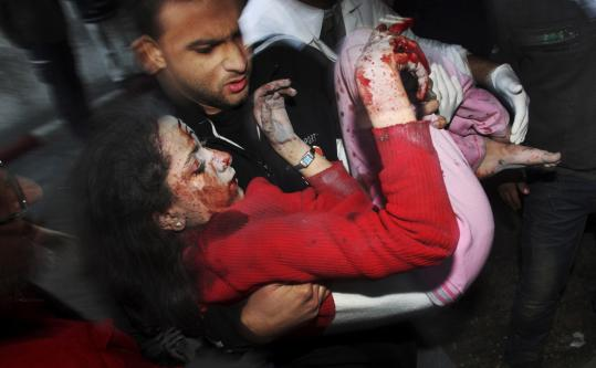 A Palestinian man carried a wounded girl to a Gaza City hospital yesterday.