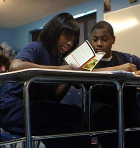 Aliyah Marsh and Derek Welcome prepared for their eighth-grade reading class at the Roxbury Preparatory Charter School.