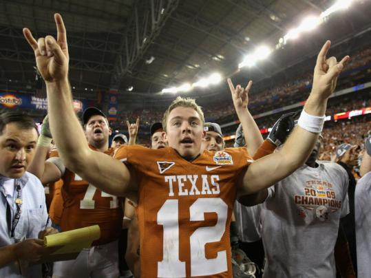 Quarterback Colt McCoy led the celebration after rallying Texas with a last-minute TD pass to beat Ohio State.