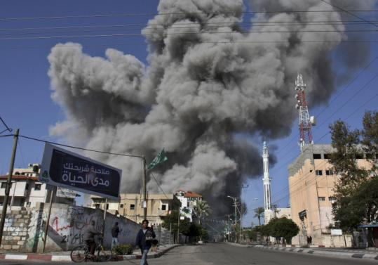 Smoke rose from the Hamas central security headquarters and prison after an Israeli missile strike in Gaza City on Dec. 28. The site, used by a series of Gaza's rulers, is now rubble.