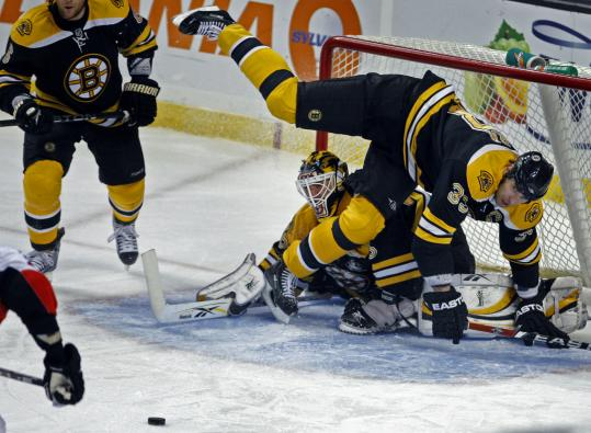 Zdeno Chara falls over Bruins goalie Manny Fernandez in the second period, leading to the Senators' second goal.