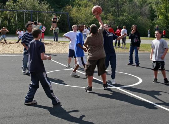 The playground at Holbrook's South Elementary School was rebuilt through a community wide volunteer effort.