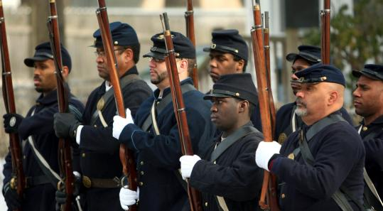 Reenactors of the 54th Massachusetts Volunteer Regiment rehearsed for their part in Barack Obama's inauguration parade in Washington. Below, Benny White of Mattapan gave instructions.