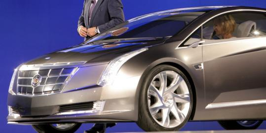 Bob Lutz, vice chairman of General Motors Corp., displayed the Cadillac Converj, designed to go 40 miles on electric power.