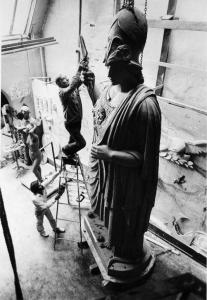 Adio diBiccari worked on his Athena statue as his assistant Bob Shure held the ladder.
