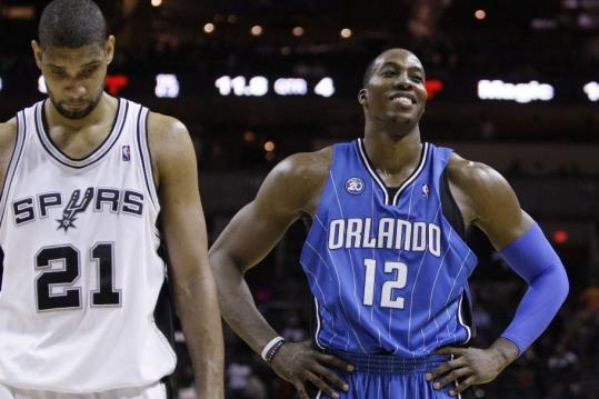 Dwight Howard can afford to smile as Orlando put away Tim Duncan's Spurs.