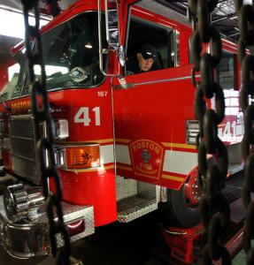 Diego Muneton, a technician at Arcand Spring Co. in Allston, inspected the brakes yesterday on Fire Engine 41.